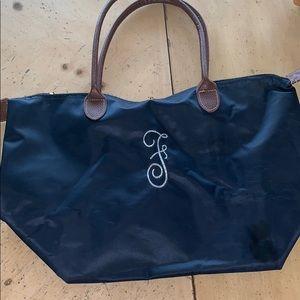 Handbags - F embroidered navy pocketbook